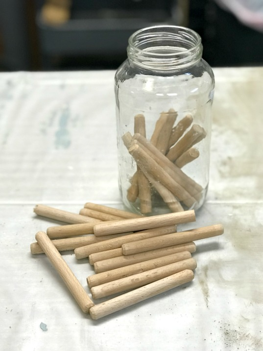 wooden dowel pegs for twine organization
