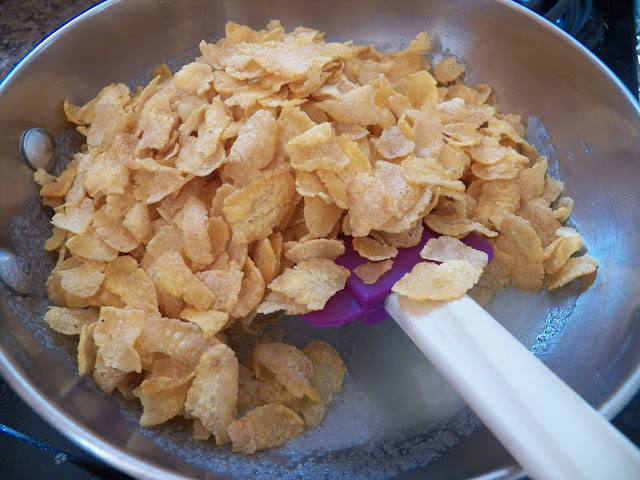 Cornflakes added to pan of butter and sugar