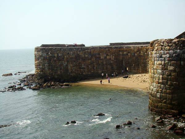 "Sindhudurg is part of Konkan (coastal) region, a narrow coastal plain in western Maharashtra which is bordered on the north by Ratnagiri District, on the south by the state of Goa, on the west by the Arabian Sea, and to the east across the crest of the Western Ghats or Sayadhris is Kolhapur District. Sindhudurg district was earlier a part of the Ratnagiri District. For administrative convenience and industrial and agricultural development Ratnagiri district was divided into Ratnagiri and Sindhudurg with effect from 1st May, 1981. Sindhudurg district now comprises of eight tahsils of Sawantwadi, Kudal, Vengurla, Malvan, Devgad, Kankavli, Vaibhavwadi and Dodamarg. The district headquarters are located at Oros. The district occupies an area of 5207 km². The district is named after the fort of Sindhudurg (which means ""Fort in the Sea""), which lies on a rocky island just off the coast of Malvan. The Land of Culture and Natural beauty. Sindhudurg is famous for its natural beauty like Beaches, Backwater, Waterfalls and Pilgrimage centers. The major attraction here is the long and narrow stretch of beaches. On a clear day, you can see the sea-bed through a depth of 20 ft. Then of course, there are the forts, Sindhudurg one of Maharashtra's more popular and important sea forts built in the 17th century and the famous Padmagarh fort. The name of the fort is given to the Sindhudurg district. The 8 talukas of this district are Devgad, Kankavali, Malvan, Kudal, Savantwadi, Vengurla, Dodamarg and Vaibhavwadi. There are 4 Vidhan Sabha constituencies in this district. These are Sawantwadi, Vengurla, Malvan and Devgad. All of these are part of the Rajapur Lok Sabha constituency."