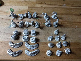 Array of unpainted worms minis