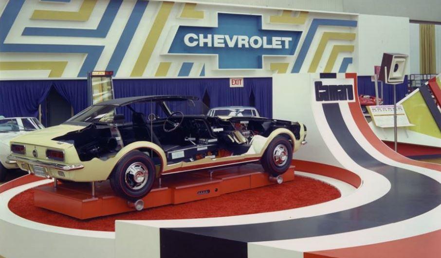 Just A Car Guy: 1967 Chevrolet Camaro car on platform at trade show.