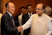 Indian Finance Minister Arun Jaitley, right, shakes hand with World Bank President Jim Yong Kim, in New Delhi, India, Thursday, June 30, 2016. The World Bank Group Thursday signed an agreement with the International Solar Alliance, consisting of 121 countries led by India, to collaborate on increasing solar energy use around the world, with the goal of mobilizing $1 trillion in investment by 2030. (Photo Credit: AP/Manish Swarup) Click to Enlarge.