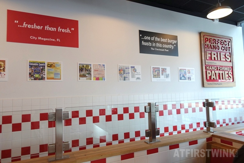 Utrecht Centraal Station Five Guys burger restaurant posters