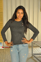 Actress Bhanu Tripathri Pos in Ripped Jeans at Iddari Madhya 18 Movie Pressmeet  0056.JPG