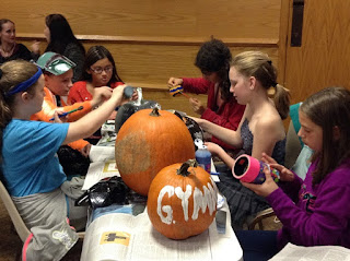 teens paint pumpkins