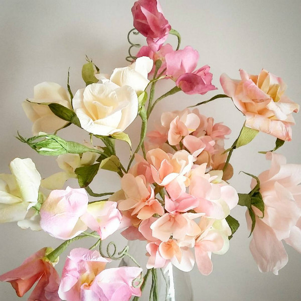 Crepe paper sweet pea bouquet in peach, pink, and deep pink