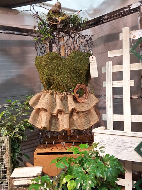 wire dress form dressed in moss and burlap
