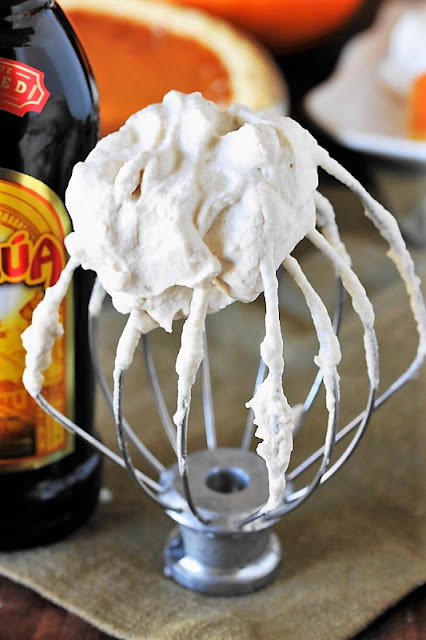 Kahlua Whipped Cream image ~ When it comes to Thanksgiving and Christmas dinner, there's always room for pie!  Especially when it's topped with a delicious dollop of freshly-whipped Kahlua Whipped Cream.  Enjoy this spiked whipped cream on pumpkin, pecan, apple, or chocolate pie ... or any other dessert that strikes your fancy.