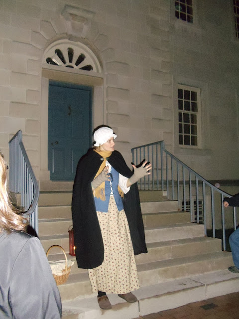 Tour guide from Footsteps from the Past tells a ghostly tale in front of Carlyle House