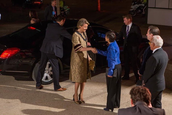 Queen Mathilde wore Dries Van Noten coat and dress gold metallic dress. metallic shoes, gold diamond earrings