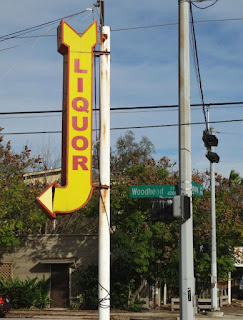 Bright yellow old-style liquor stire sign