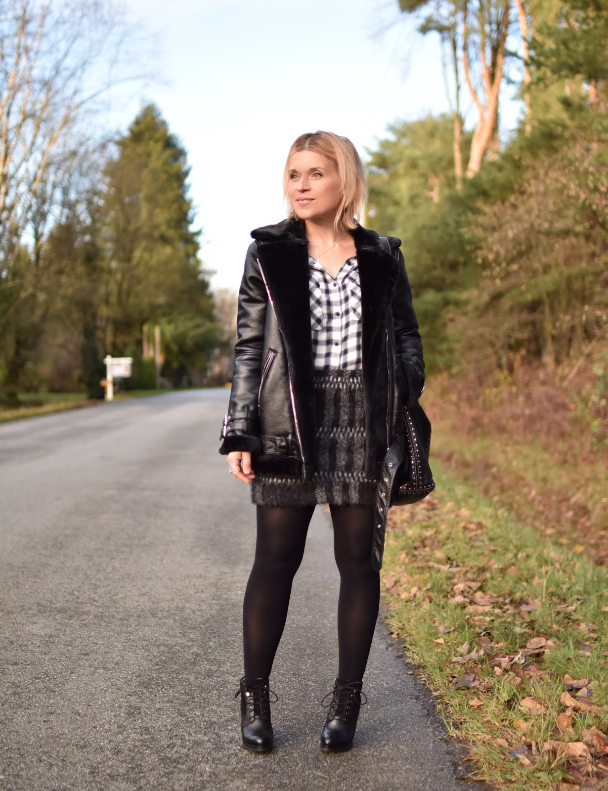 Monika Faulkner outfit inspiration - styling a mohair miniskirt with a plaid shirt, opaque tights, lace-up booties, and a moto-inspired coat