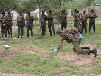 Police officers demonstrate how to deal with a mine in Kitui County. PHOTO | File
