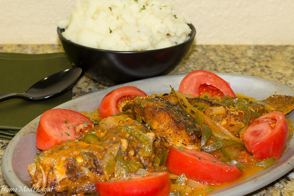 Brown Stew Fish - A quintessential Jamaican dish of fried fish then simmered in a sweet and tangy sauce. #HomeMadeZagat