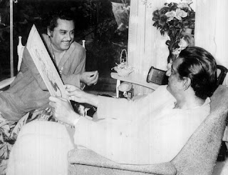 Kishore Kumar is with Satyajit Ray in the picture