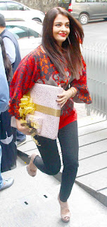 Aishwarya Rai Walking With A Holding Gift In Hands
