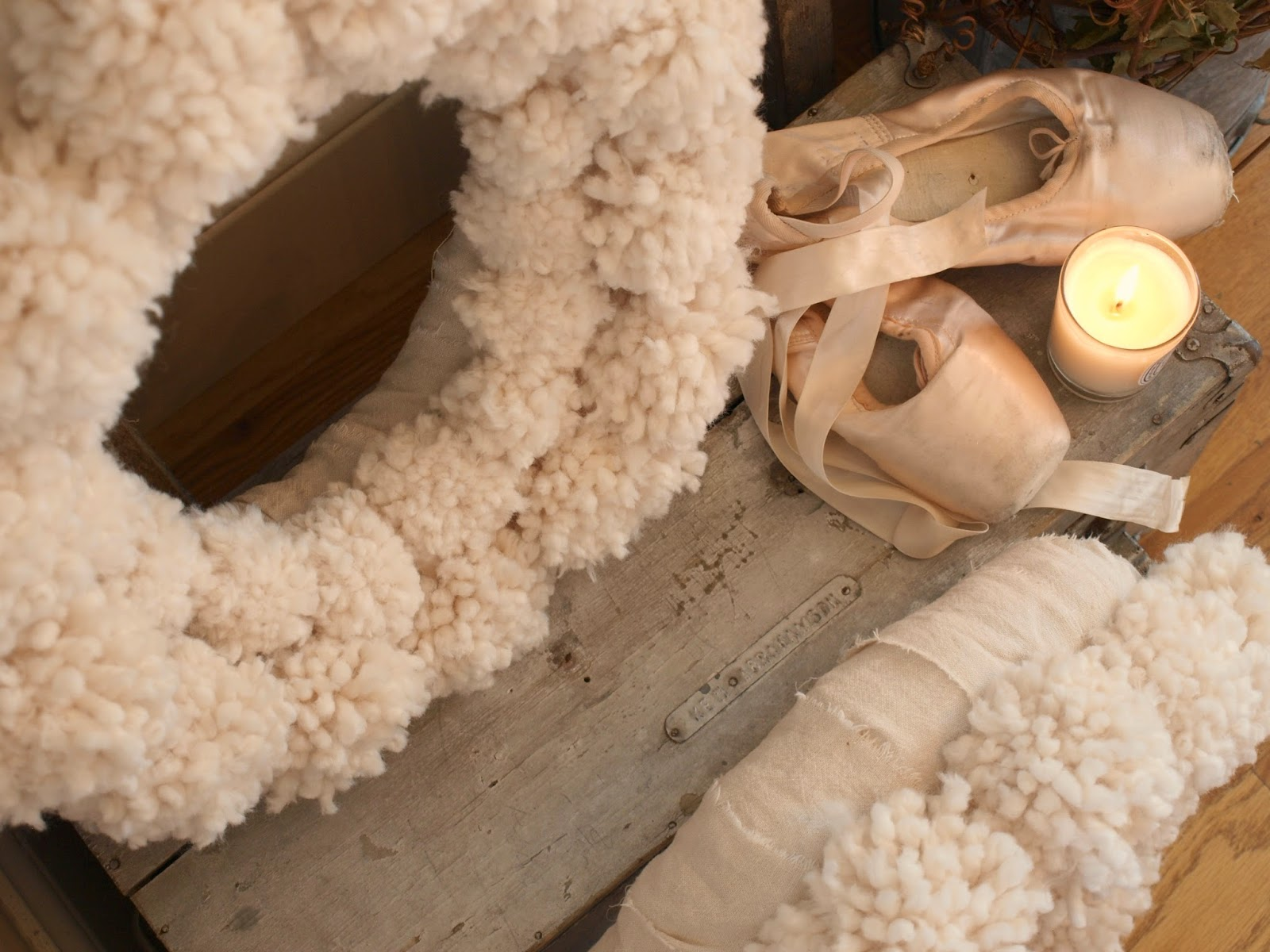 Cozy woolly white pom pom wreaths, pink pointe shoes, and vintage box