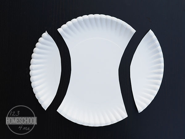 cut oval edge off of both sides of the paper plate