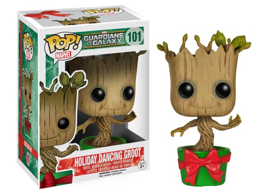 A bobblehead of an anthropomorphic tree growing out of a green pot adorned with a red bow. It appears alongside a packaged version of the same figure in a rectangular box with an illustration of the character on the side.