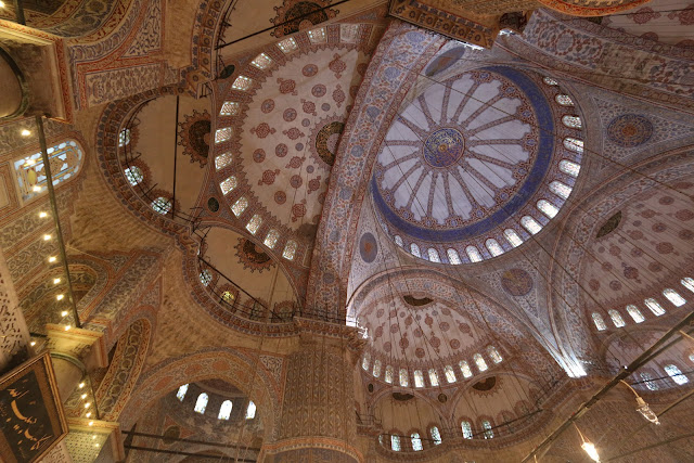 The interior is lit with 260 windows which were once filled with 17th Century stained glass but sadly they were lost and replaced by replicas at Blue Mosque in Sultanahmet Square in Istanbul, Turkey