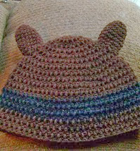 http://www.ravelry.com/patterns/library/crochet-racoon-beanie