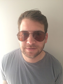 Husband trying on sunglasses from perfect glasses