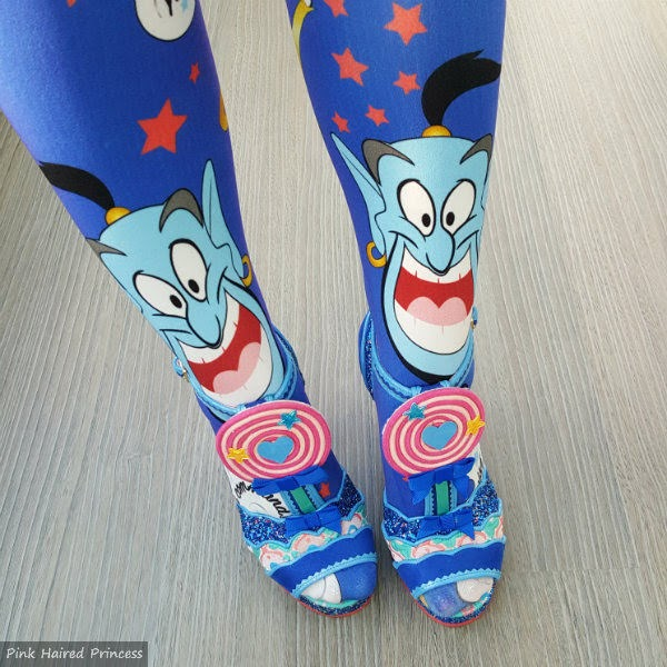 legs standing wearing Aladdin Genie tights with blue lollipop sandals