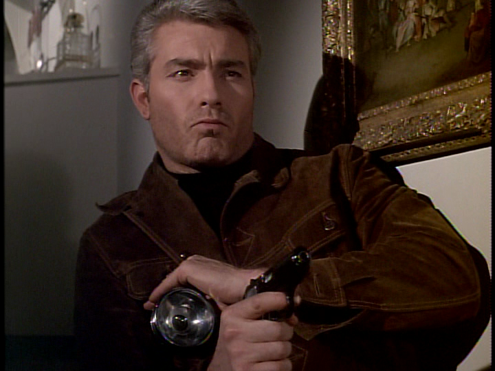 McGill+with+pistol+and+flashlight+Walther+PPK+gun+leather+jacket+Richard+Bradford+Man+in+a+Suitcase.png