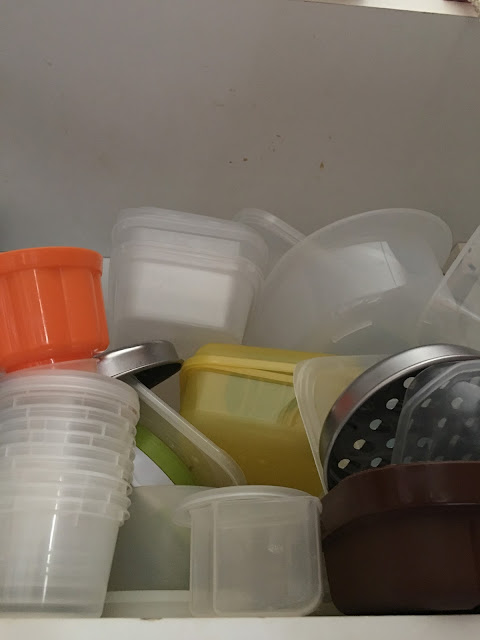 plastic tubs in cupboard