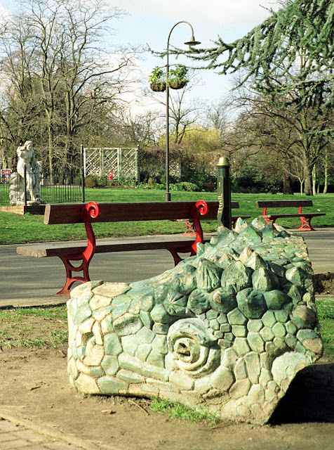Crystal Palace Park, 1990s.  Spare dinosaur head in the foreground.