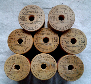 embossed wooden thread spools