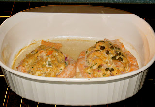 Copycat Costco crab & shrimp stuffed salmon. Baked with a hint of wine & topped with a mayo & Sriracha sauce, it is amazing! This is fish elevated!