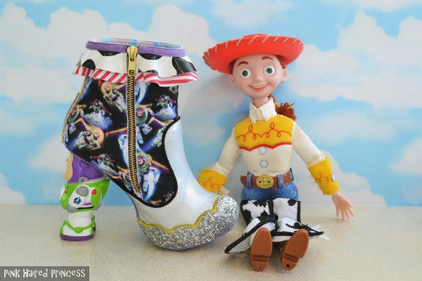 inner side of buzz lightyear ankle boot showing zip sitting next to large jessie doll