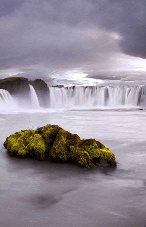 The Goðafoss  is one of the most spectacular waterfalls in Iceland. It is located in the Bárðardalur district of North-Central Iceland at the beginning of the Sprengisandur highland road. The water of the river Skjálfandafljót falls from a height of 12 meters over a width of 30 meters.