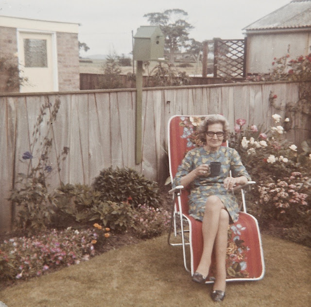 snapshots grandma in the backyard enjoying a cup of coffee. 1950s Good Heavens and Other stories of Matronly Women. marchmatron.com