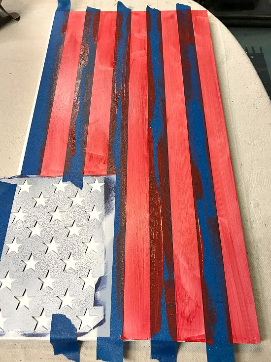 Taped and painted stripes for flag