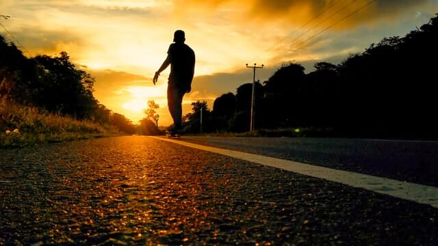 Silhouette Photo Of Man Riding Skateboard HD Copyright Free Image