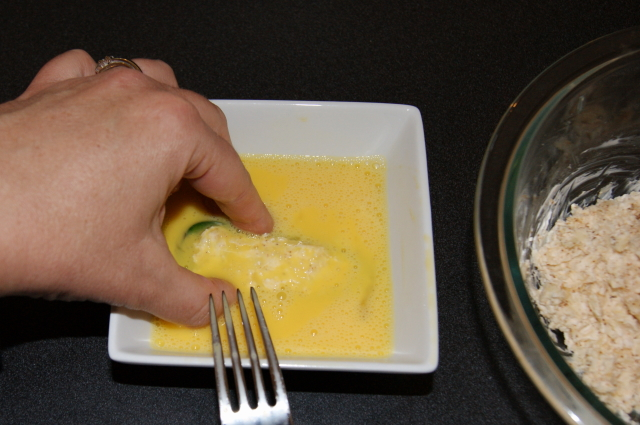 Dipping Jalapenos in Egg to Make Baked Jalapeno Poppers Image