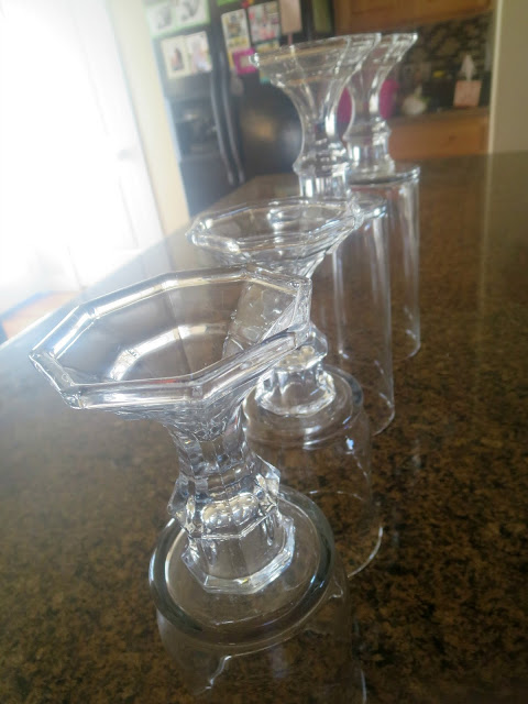 DIY Dollar Store Hurricane Vases--Use dollar store glass vases and candlesticks to make these inexpensive hurricane vases!
