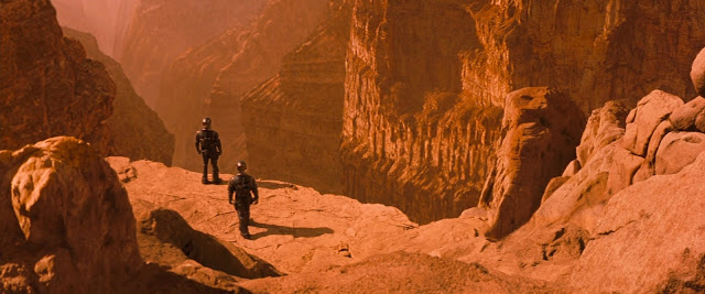 Astronauts at edge of Martian canyon from Red Planet movie