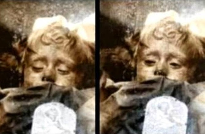 Mystery of the 'blinking' child mummy solved