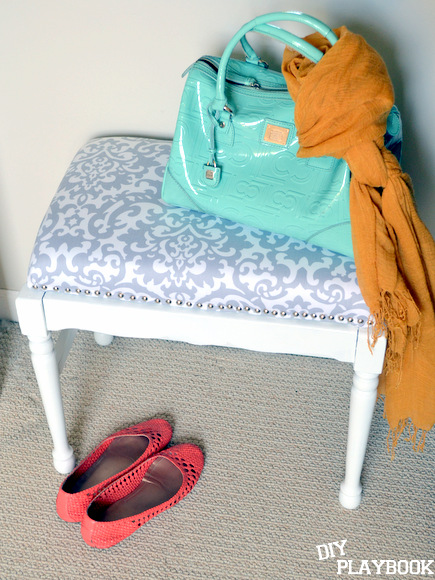 White nailhead trim bench with purse scarf and flats