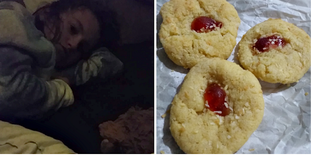 my daughter in bed not wanting to get up and some biscuits she had made