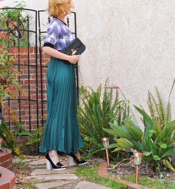 Black western clutch, Green pleated maxi skirt