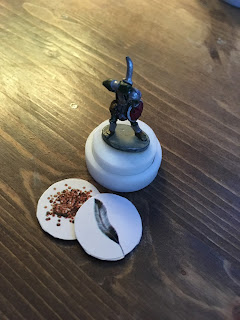 pog with miniature fixed to top