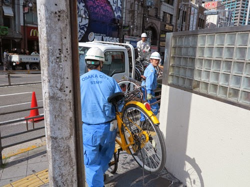 Osaka City staff collecting illegally parked bicycles in Tennoji