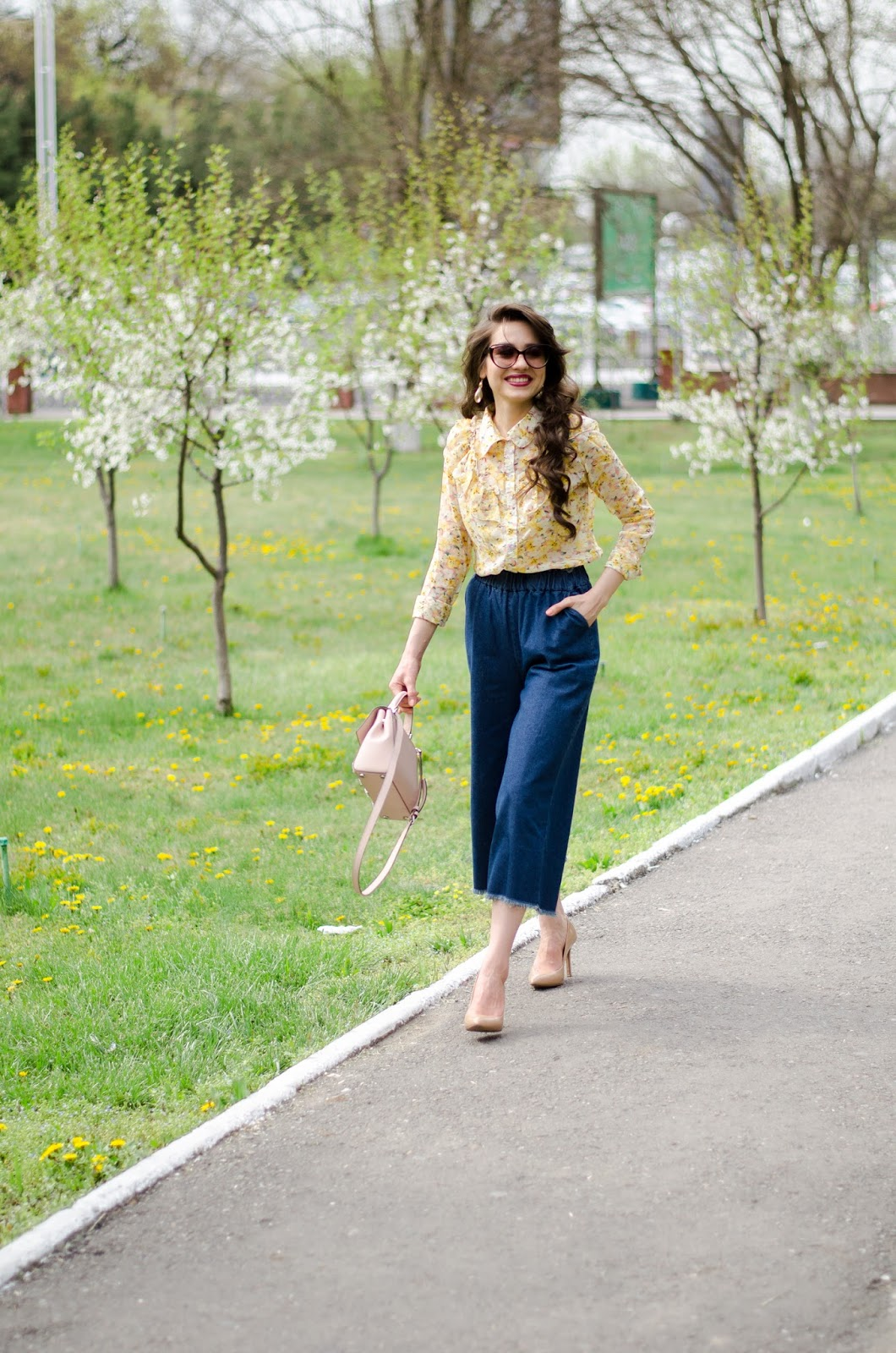 fashion blogger diyorasnotes diyora beta yellow blouse with ruffles denim cullote heels spring outfit michael kore bag