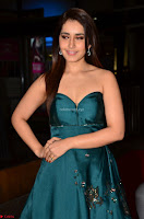 Raashi Khanna in Dark Green Sleeveless Strapless Deep neck Gown at 64th Jio Filmfare Awards South ~  Exclusive 043.JPG