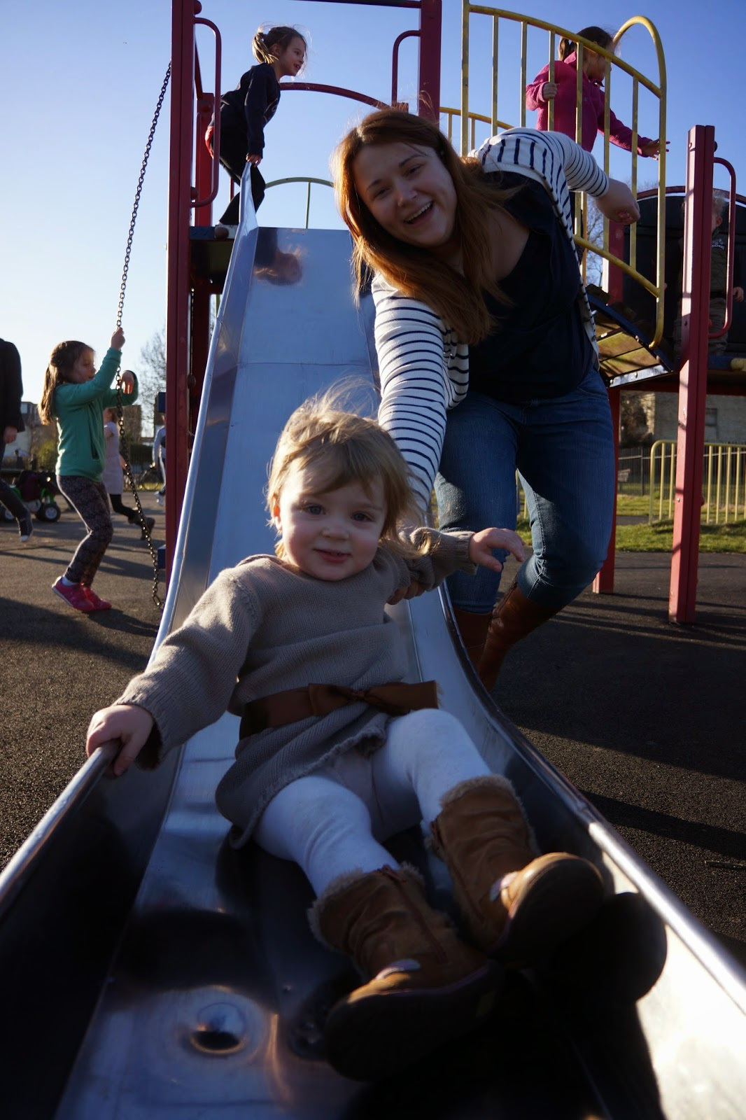 toddler on slide with mummy