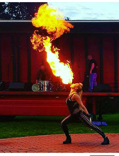 A fire eater doing her thing
